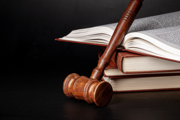 wooden-gavel-juridical-books-close-up_93675-69432